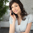 A brunette woman at phone — Stock Photo #11510717
