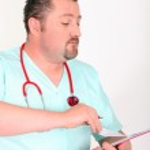 Male nurse watching a paper — Stock Photo