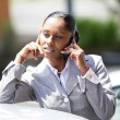 Stock Photo: Businesswoman stood by car making telephone call