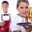 Barman and waitress — Stock Photo
