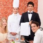 Restaurant staff stood with customers — Stock Photo
