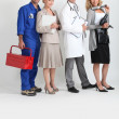 Mechanic, secretary, doctor and hairdresser. — Stock Photo