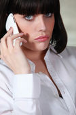 Upset brunette making telephone call — Stock Photo