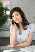 A brunette woman at phone — Stock Photo