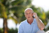 Elderly man talking on his mobile phone — Stock Photo