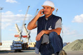 Workers in front of cranes — Stock Photo