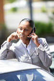 Businesswoman stood by car making telephone call — Stock Photo