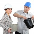 Man and woman with brick and cement — Stock Photo