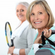 Two mature women playing tennis. — Stock Photo #11636095