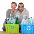 Enthusiastic couple recycling — Stock Photo #11636113