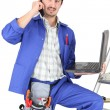 Foto Stock: Plumber with tools