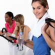 Female trio in fitness center — Stock Photo #11636185