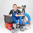 Royalty-Free Stock Photo: Female plumber with tools of the trade and a laptop computer