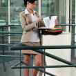 Businesswoman reading documents — Stock Photo