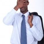 A black businessman hiding his face. — Stock Photo #11636507