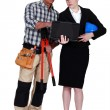 Architect and builder with a laptop — Stock Photo