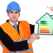 Stock Photo: Surveyor holding energy rating poster