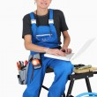 Woman plumber using laptop computer — Stock Photo