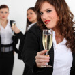Three young business women toasting success — Stock Photo