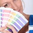 Painter holding a spectrum of colour samples - Stock Photo