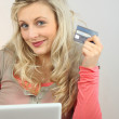 Portrait of a woman making online purchases — Stock Photo #11637514