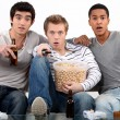 Stock Photo: Men watching a horror movie