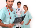 Nurse looking at ultrasound — Stock Photo