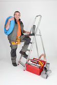 Labourer climbing step-ladder — Stock Photo
