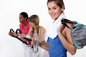 Female trio in fitness center — Stock Photo