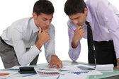 Two financial experts analyzing data — Stock Photo