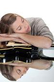 Young woman asleep over her guitar — Stock Photo