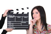 A woman posing near a movie clap — Stock Photo