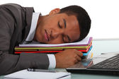 Businessman asleep at desk — Stock Photo