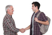 Two casual men shaking hands — Stock Photo