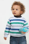 Cute toddler holding a bottle — Stock Photo