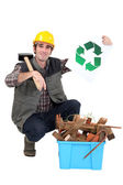 A handyman promoting recycling. — Stock Photo