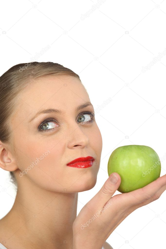 Woman in red lipstick holding a green apple  Stock Photo #11636286