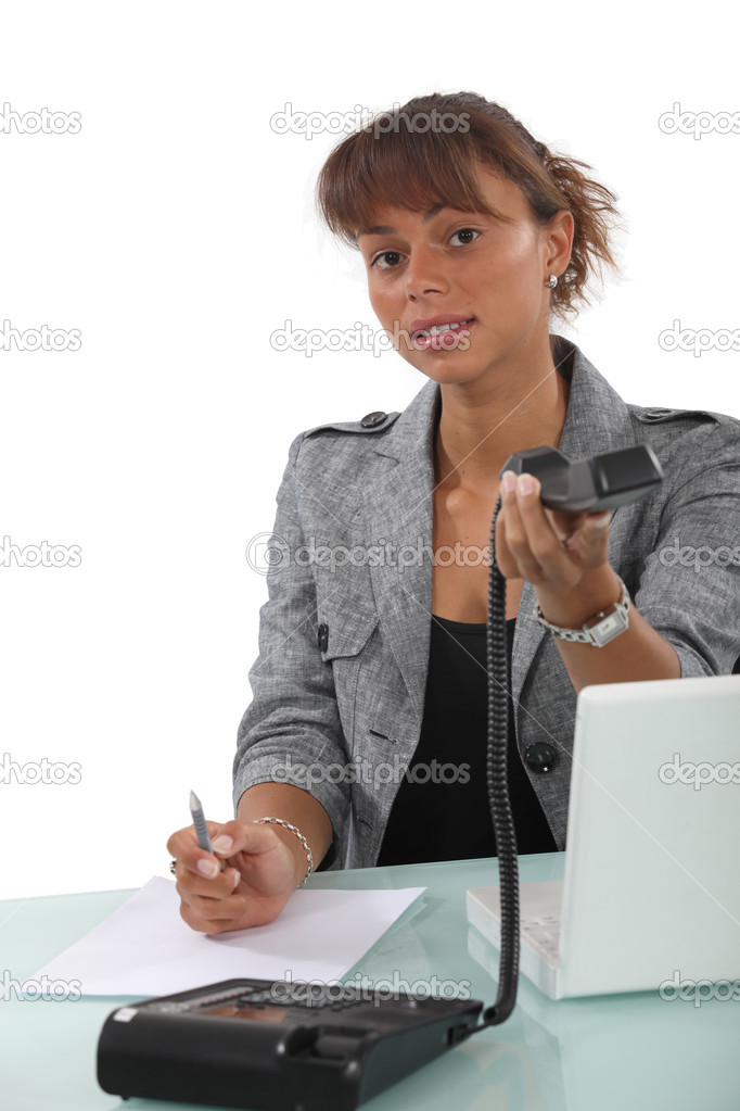 Receptionist handing  over telephone hand set — Stock Photo #11637114