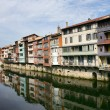 Housing along a river — Stock Photo