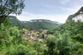 Village at the bottom of a valley — ストック写真