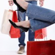 Stock Photo: Couple with shopping bags