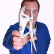 Man holding mole-grips — Stock Photo