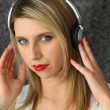 Woman wearing headphones — Stock Photo