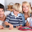 Family playing dice — Stock Photo