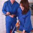 Stock Photo: Trainee plumber being supervised by teacher