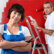 Couple painting wall in red — Stock Photo #11747584