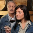 Stock Photo: Womtasting wine in cellar