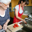 Stock Photo: Grandmother and granddaughter cooking