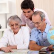 Grandparents and grandson preparing travel — Stock Photo