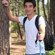 Young man walking in the woods — Stock Photo #11748786